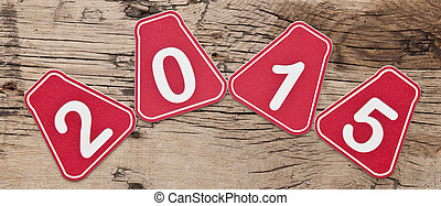 Numbers 2015 on old brown wooden background
