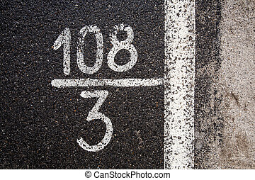 Numbers and digits on the asphalt