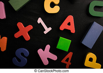 Numbers, letters and blocks on a black background