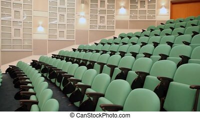 empty green armchairs in lecture hall amphitheatre