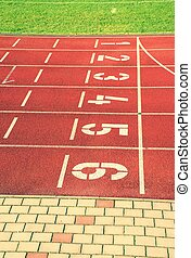 Numbers of tracks. Red running racetrack on the outdoor athletic stadium