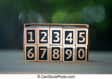 Numbers of wood blocks begin 1 to 0. Learning education concept.
