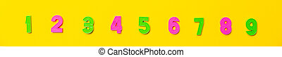 Numbers set 1, 2, 3, 4, 5, 6, 7, 8, 9. Colorful plastic numerals isolated on yellow background. Numerals for poster or site head. Preschool distance education banner. Math online course. Funny count
