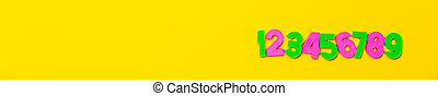 Numbers set 1, 2, 3, 4, 5, 6, 7, 8, 9. Colorful plastic numerals isolated on yellow background. Poster or site head. Preschool distance education banner. Math online course. Funny count. Copy space