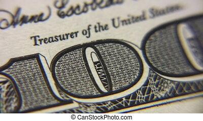 Numeral one hundred dollar bills macro, rotating