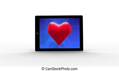Numeric tablet with red heart in blue background