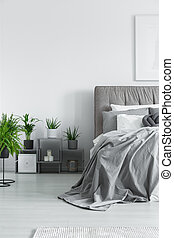 Numerous plants in bedroom - Numerous plants standing next...