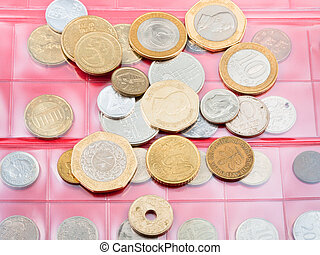 numismatics album with different coins - red page of...