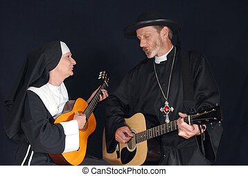 Nun and priest singing - Middle aged nun and priest playing...