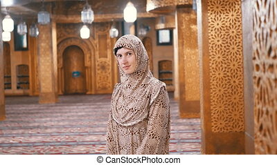 Nun in Robe Stands Inside an Islamic Mosque. Egypt - Nun in...