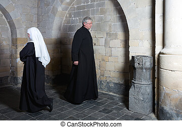 Nun passing priest