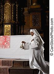 Nun ringing bells during consecration - Nun ringing copper ...