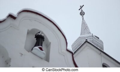 Nun Statue on Church - Shifting focus from a church spire to...