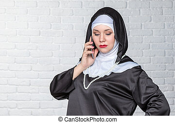 Nun talking on the phone