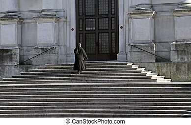 nun who climbs the stairs of the Church