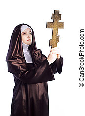 Nun with cross - Full growth photo of young catholic nun...