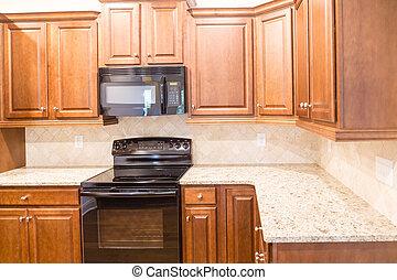 nuovo, cucina, con, granito, countertops, e, nero, apparecchi