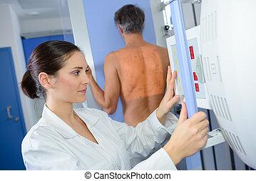 Nurse activiting xray machine
