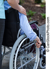 Nurse and disabled in a garden