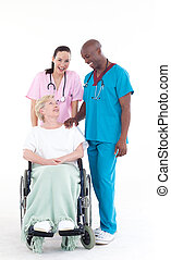 Nurse and doctor taking care of a patient in a wheel chair
