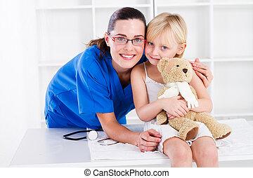 nurse and little girl patient