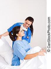 nurse and patient - friendly female nurse helping patient...