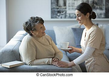 Nurse and smiling grandmother
