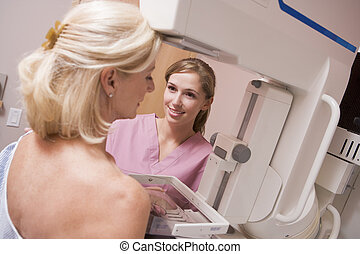 Nurse Assisting Patient Undergoing Mammogram