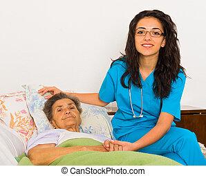Nurse at Home - Kind nurse woman with senior patient at...