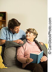 Nurse caring about senior patient