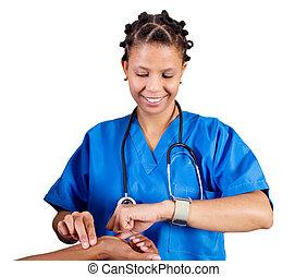 nurse checking patient's pulse