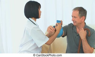 Nurse checking the blood pressure