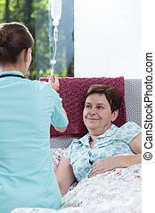 Nurse checking the drip