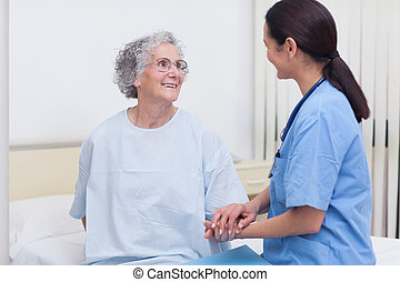 Nurse comforting a patient