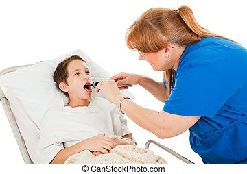 Nurse uses a tongue depressor and otoscope to examine little boy in hospital.