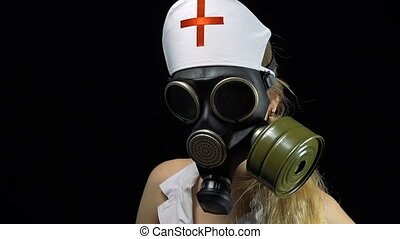 Nurse girl in gas mask - Footage of sexual young nurse on...