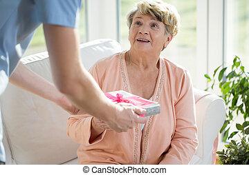 Nurse giving a gift