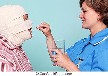 Nurse giving a patient some medicine