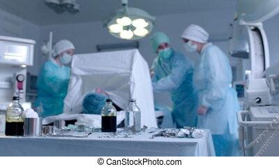 Nurse Giving a Tissue Forceps to Surgeon