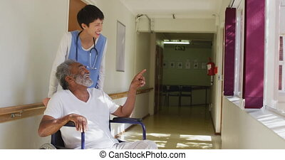 Nurse helping a senior man in retirement house