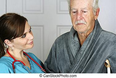 Nurse Helping a Senior on His Crutch