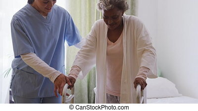 Nurse helping a senior woman in a retirement home