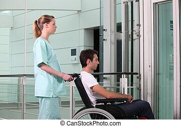 Nurse helping man in wheelchair