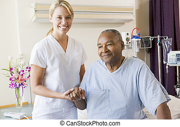 Nurse Helping Senior Man To Walk