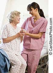 Nurse Helping Senior Woman To Walk