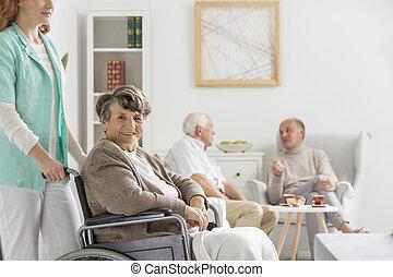Nurse helps happy senior