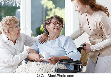 Nurse helps senior woman