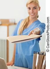 Nurse holding a file