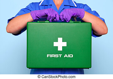 Photo of a nurse in uniform holding a green first aid kit.