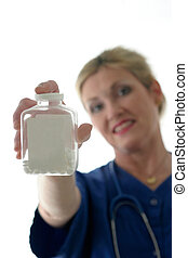 nurse holding bottle of pills with blank label